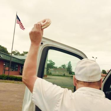 Steve grabbing a donut for the road after making deliveries